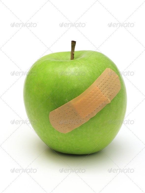 band-aid over apple - Stock Photo - Images