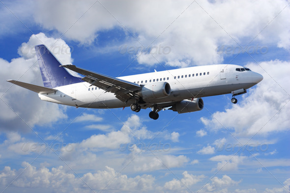 airplane on clouds - Stock Photo - Images