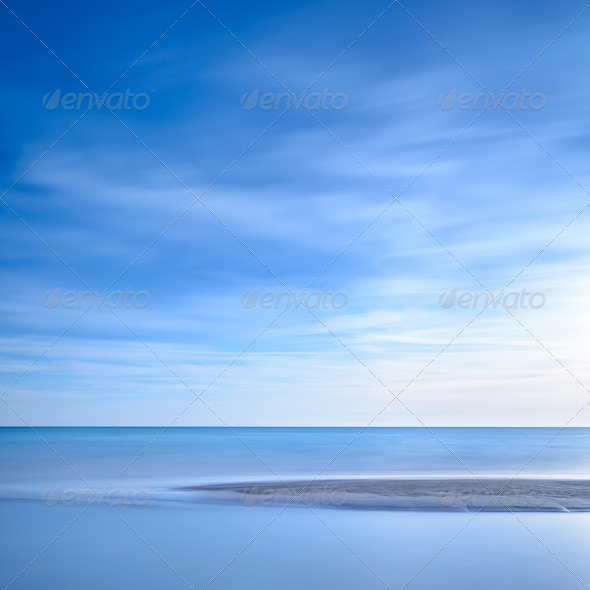 Ocean sandy beach line and blue sunset - Stock Photo - Images