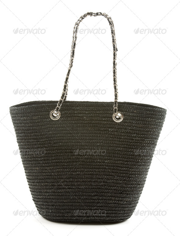 Black basket tote with chain and leather handle - Stock Photo - Images