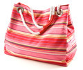 Pinkish canvas striped beach bag with rope shoulder strap
