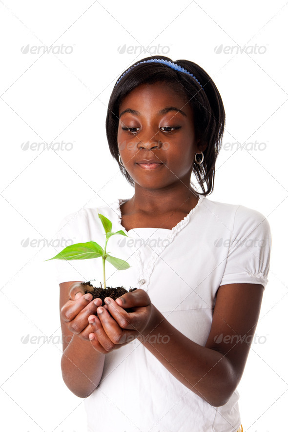Girl with plant in hand - Stock Photo - Images