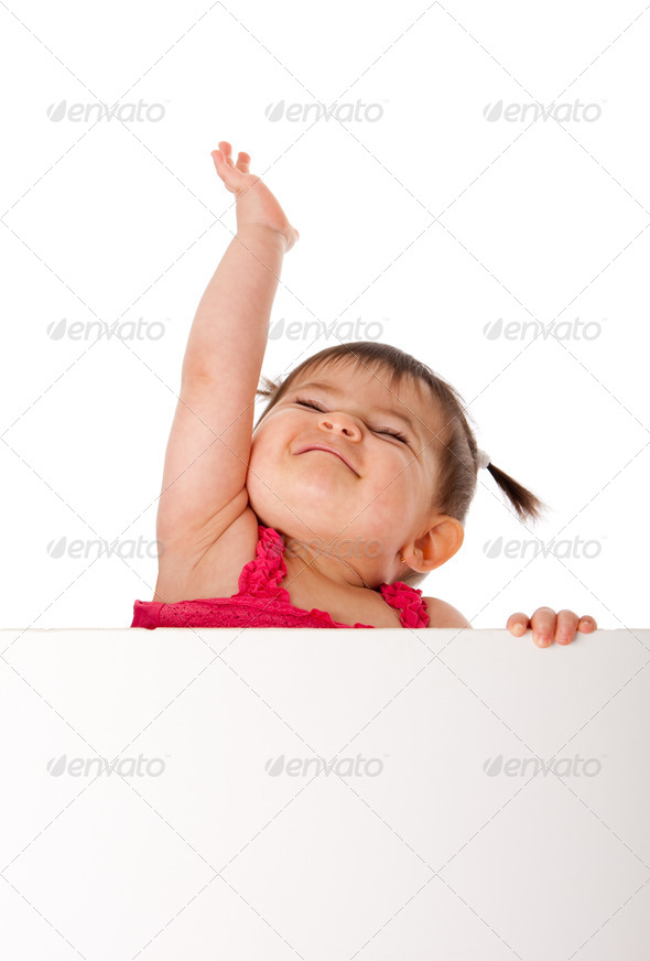 Happy baby holding white board and reaching up - Stock Photo - Images