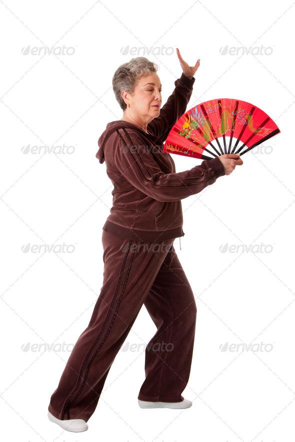 Senior woman doing Tai Chi Yoga exercise - Stock Photo - Images