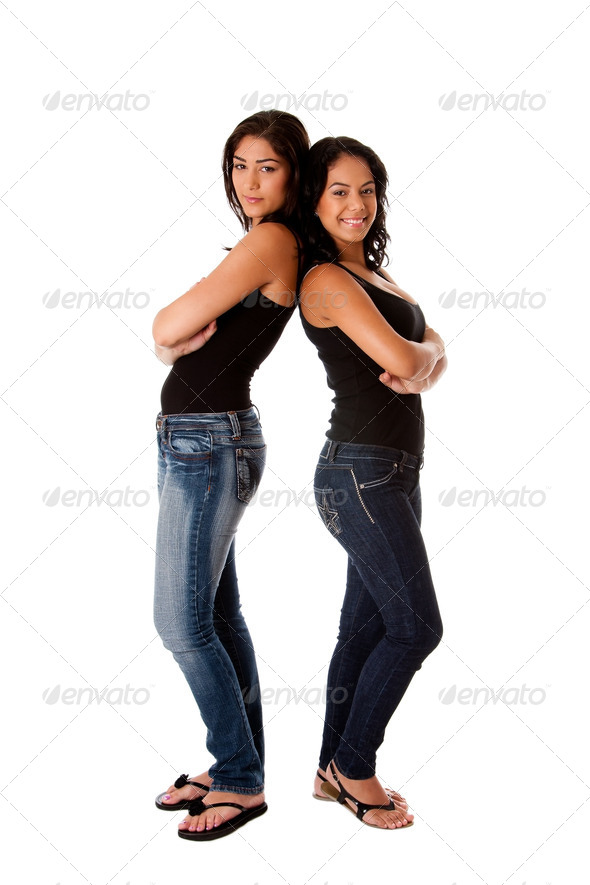 Hppy young girls back to back - Stock Photo - Images