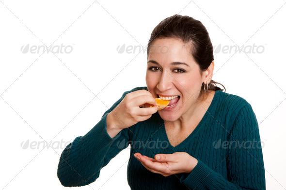 Eating juicy mandarin orange slice - Stock Photo - Images