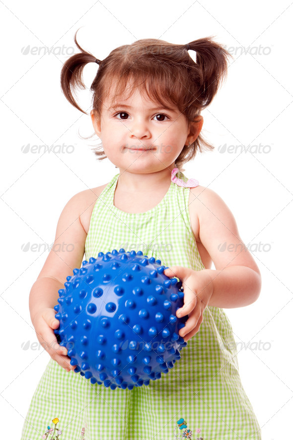 Happy toddler girl with ball - Stock Photo - Images