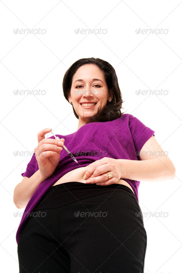 Diabetic woman injecting insulin - Stock Photo - Images