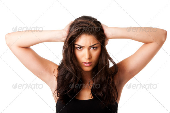Mad woman holding head - Stock Photo - Images