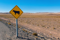 Cow sign in the andes