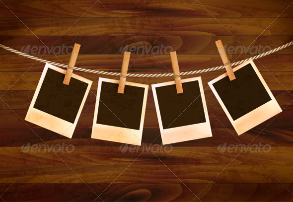 Retro Photos Hanging on a Rope on Dark Wooden Back - Retro Technology