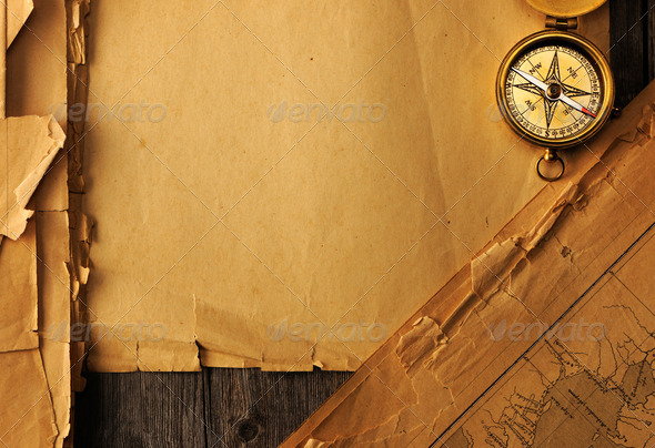 Antique compass over old map - Stock Photo - Images