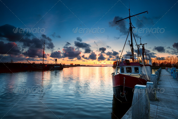fishing ships at sunset in Zoutkamp - Stock Photo - Images