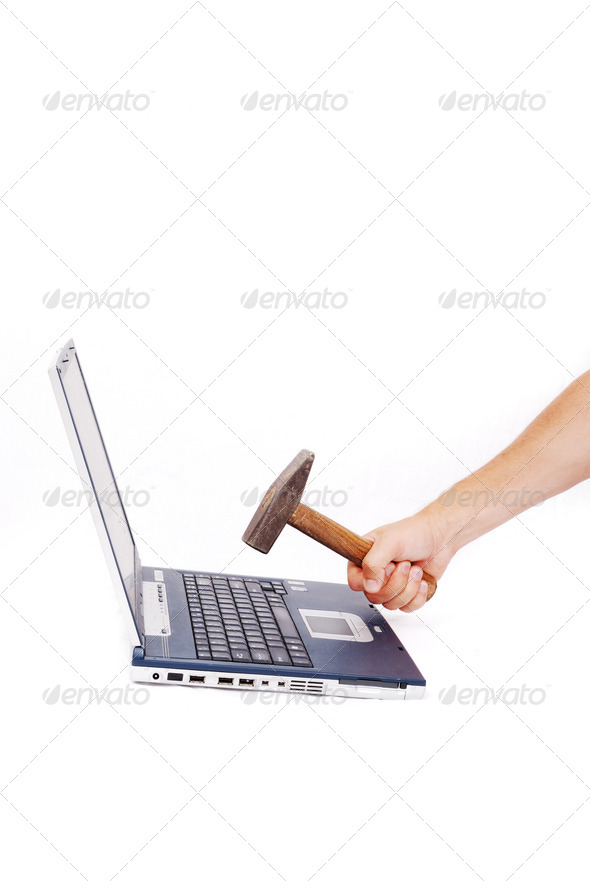 Hand over laptop about to crash it - Stock Photo - Images