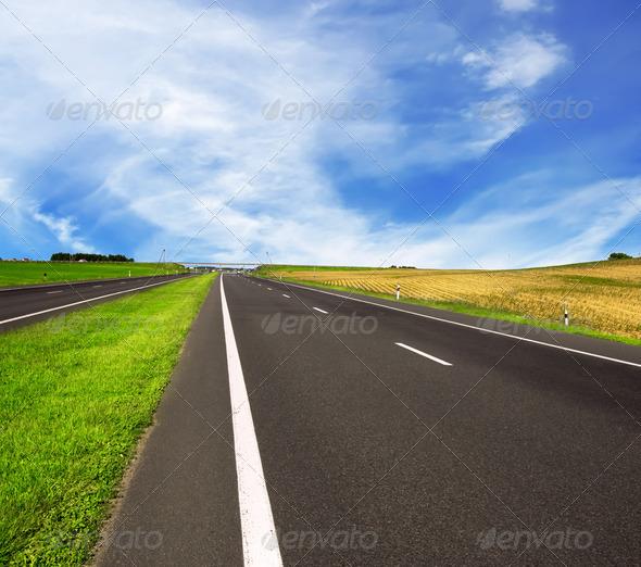 asphalt road over blue sky - Stock Photo - Images