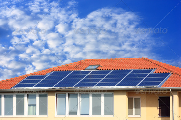 Photovoltaic solar panel on cloudy sky - Stock Photo - Images