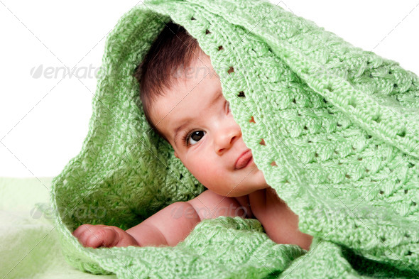 Cute happy baby between green blankets - Stock Photo - Images