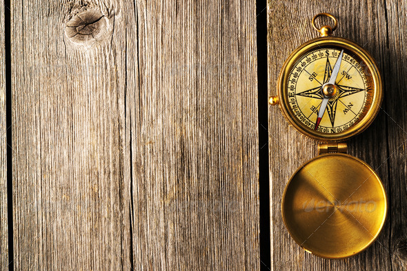 Antique compass over wooden background - Stock Photo - Images