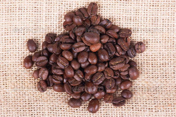 Coffee beans on sack - Stock Photo - Images