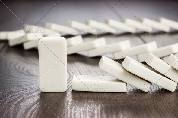 Domino Piece Standing Still Concept - Stock Photo - Images