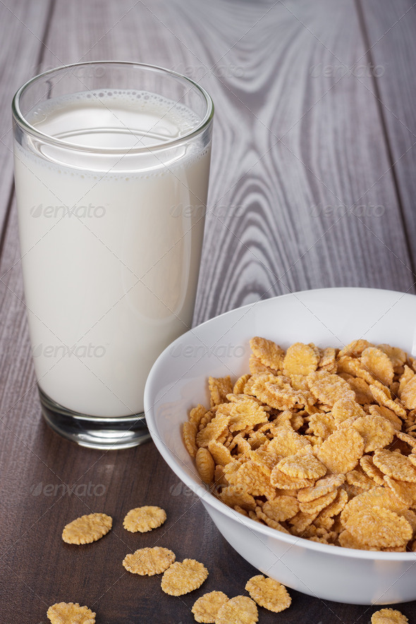 Glass Of Milk And Bowl With Cornflakes - Stock Photo - Images