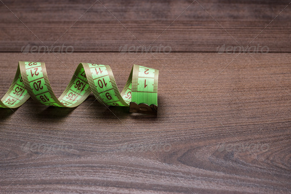 Green Measuring Tape On Wooden Background - Stock Photo - Images