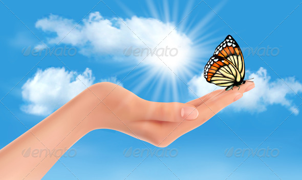 Hand Holding a Butterfly Against a Blue Sky  - Nature Conceptual