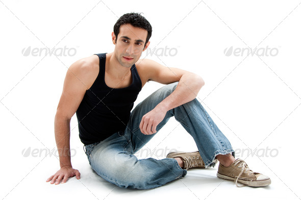 Handsome guy sitting on floor - Stock Photo - Images