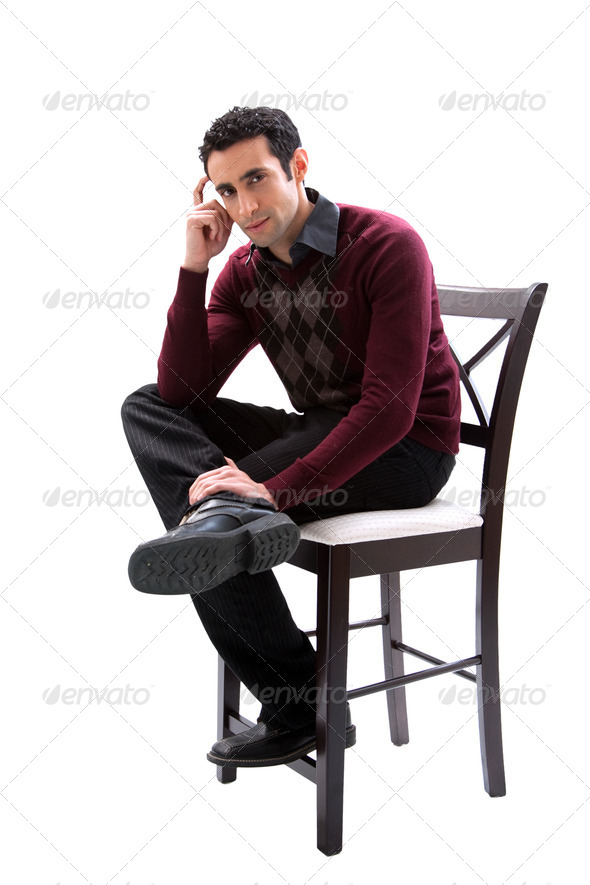 Handsome guy sitting on chair - Stock Photo - Images