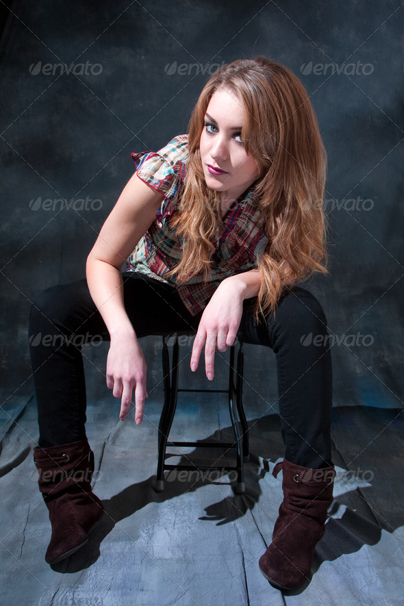 Dirty-blond sitting on stool - Stock Photo - Images