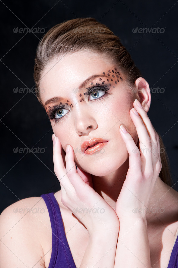 Beautiful face with Leopard print eyes - Stock Photo - Images