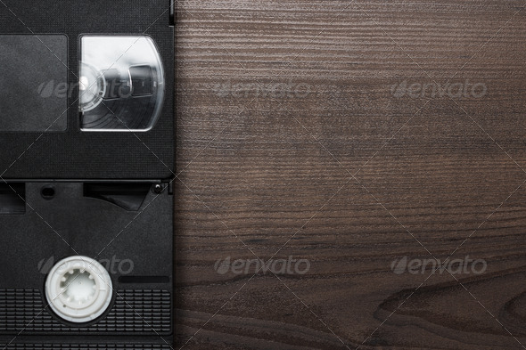 Old Retro Video Tapes Over Wooden Background - Stock Photo - Images