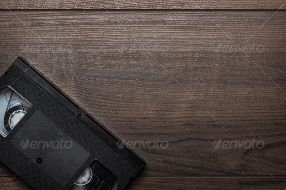 Old Retro Video Tape Over Wooden Background - Stock Photo - Images
