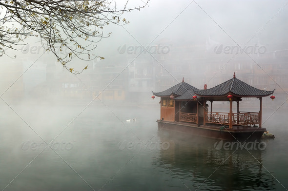China landscape of boat on foggy river - Stock Photo - Images
