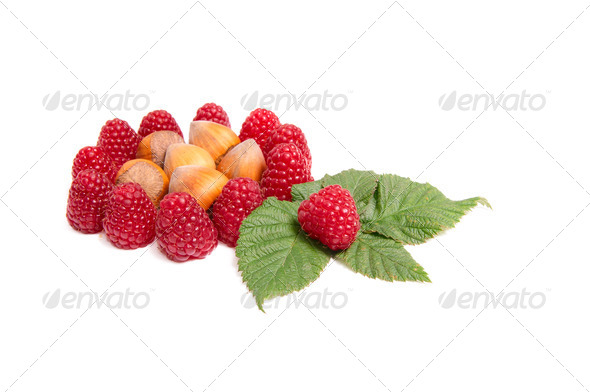 Tasty raspberries and nuts on a white. - Stock Photo - Images