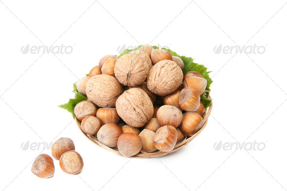 Tasty, ripe nuts in the old basket. - Stock Photo - Images