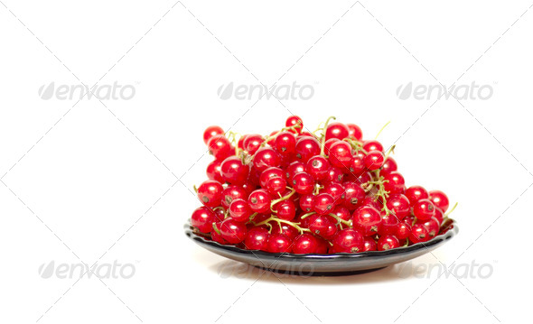 Tasty and juicy currants in brown saucer. - Stock Photo - Images