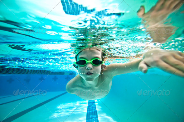 kid swimming laps - Stock Photo - Images