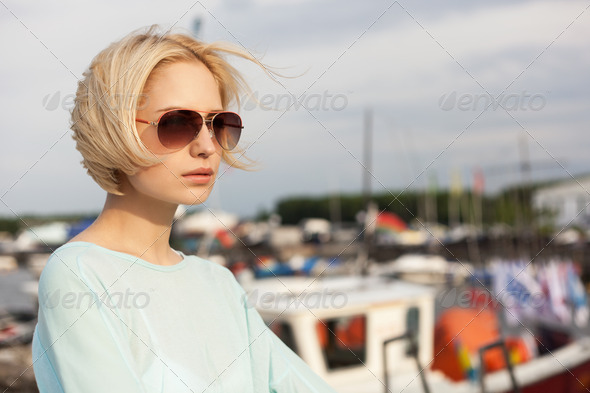Pretty girl on the sea background - Stock Photo - Images