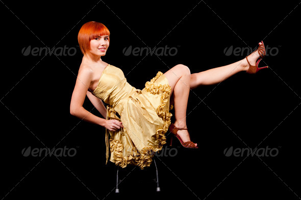 Sexy redhead in yellow dress - Stock Photo - Images