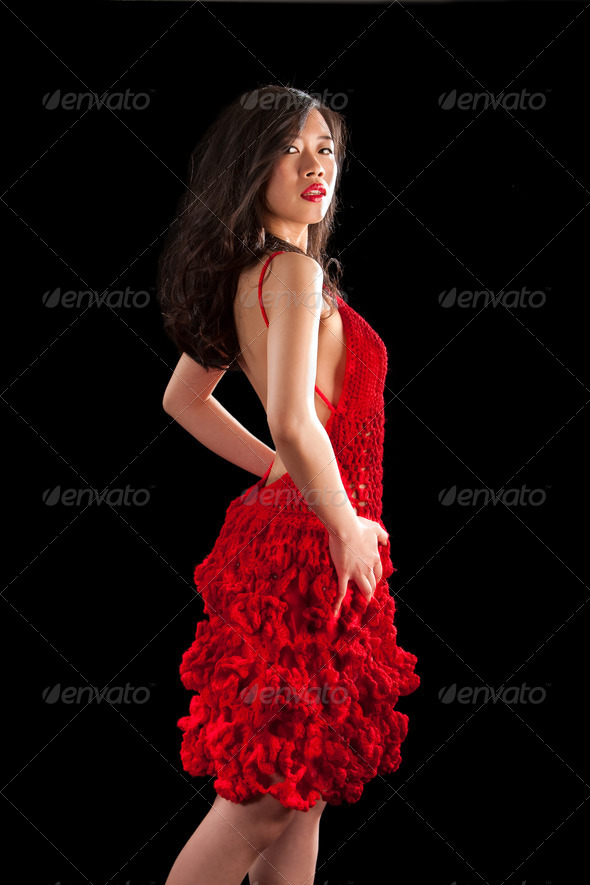 Asian woman in red crochet dress - Stock Photo - Images