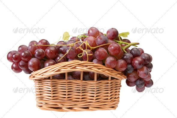 Beautiful wooden basket and ripe grapes on a white. - Stock Photo - Images