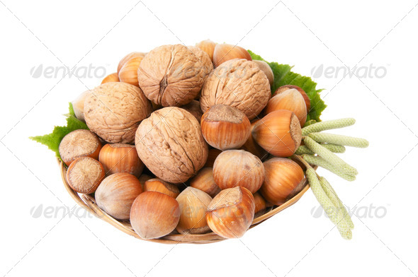 Ripe nuts in the brown basket. - Stock Photo - Images