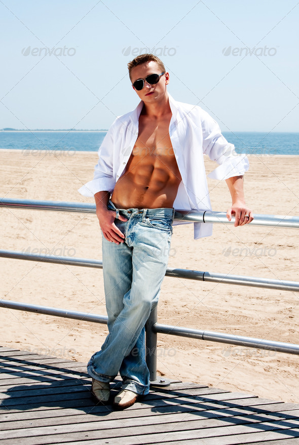 Sexy man at beach - Stock Photo - Images