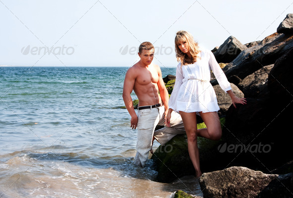 Fashion models at beach - Stock Photo - Images