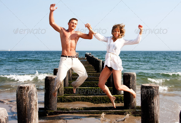 Happy couple jumping - Stock Photo - Images