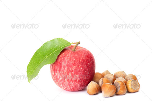 Tasty hazelnuts and fresh apple on a white. - Stock Photo - Images