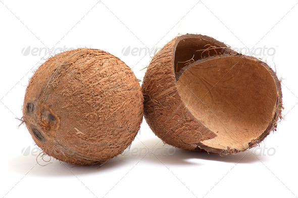 Whole and broken coconuts on a white. - Stock Photo - Images