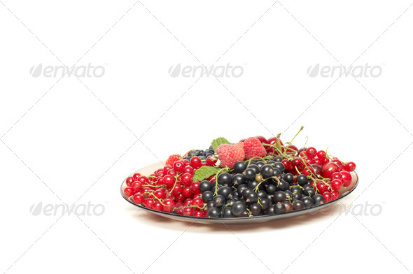 Tasty berries at the brown plate. - Stock Photo - Images