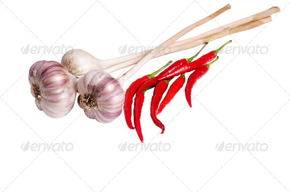 Tasty peppers and garlic on a white. - Stock Photo - Images